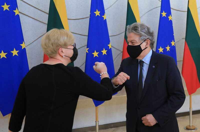 Lithuania's Prime Minister Ingrida Simonyte (L) greets European Commissioner for Internal Market Thierry Breton prior to their meeting in Vilnius on May 31, 2021.